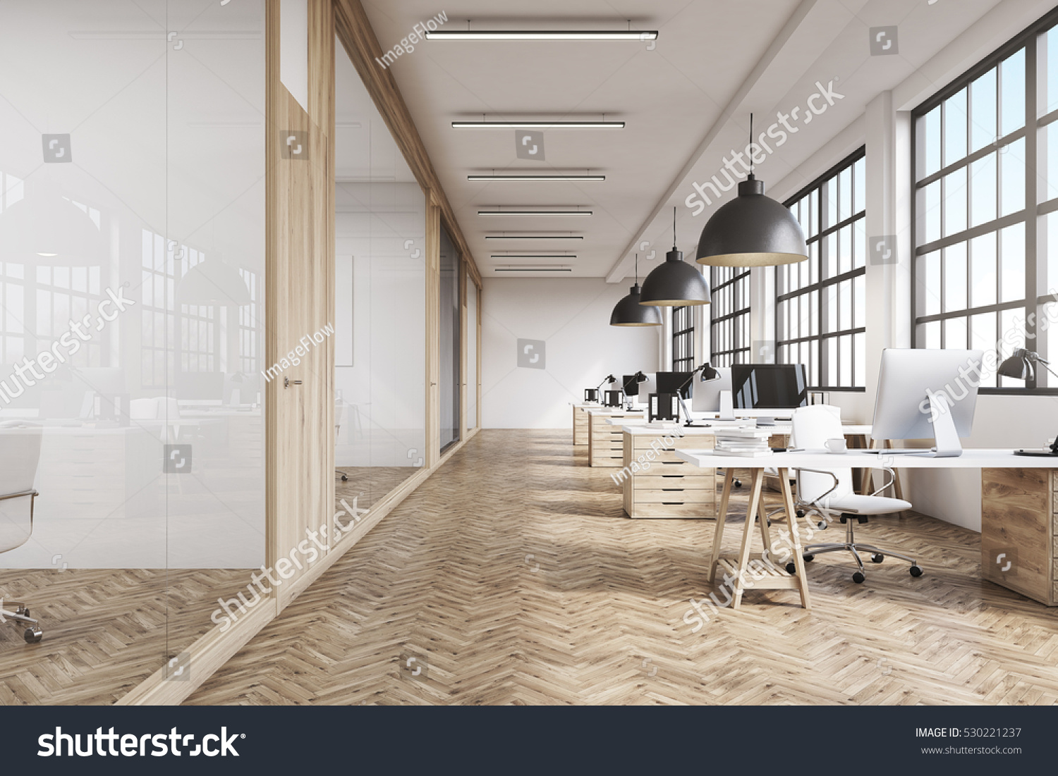 stock-photo-front-view-of-an-office-interior-with-a-row-of-dark-wood-tables-standing-under-large-windows-530221237