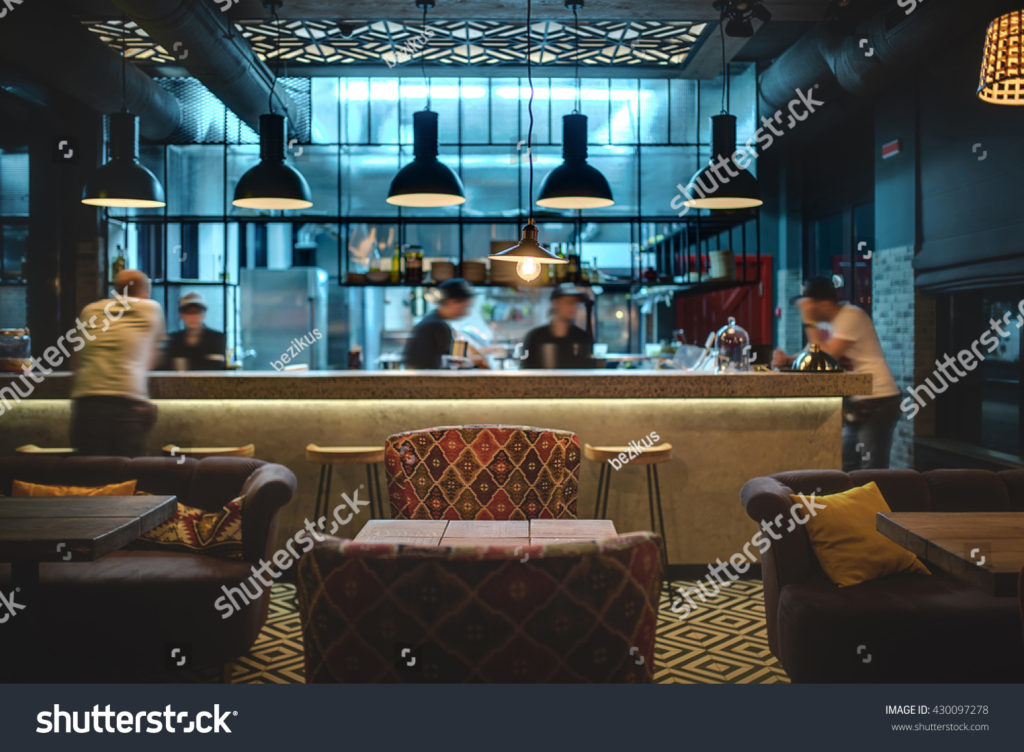 stock-photo-half-lighted-hall-in-a-loft-style-in-a-mexican-restaurant-with-open-kitchen-on-the-background-in-430097278