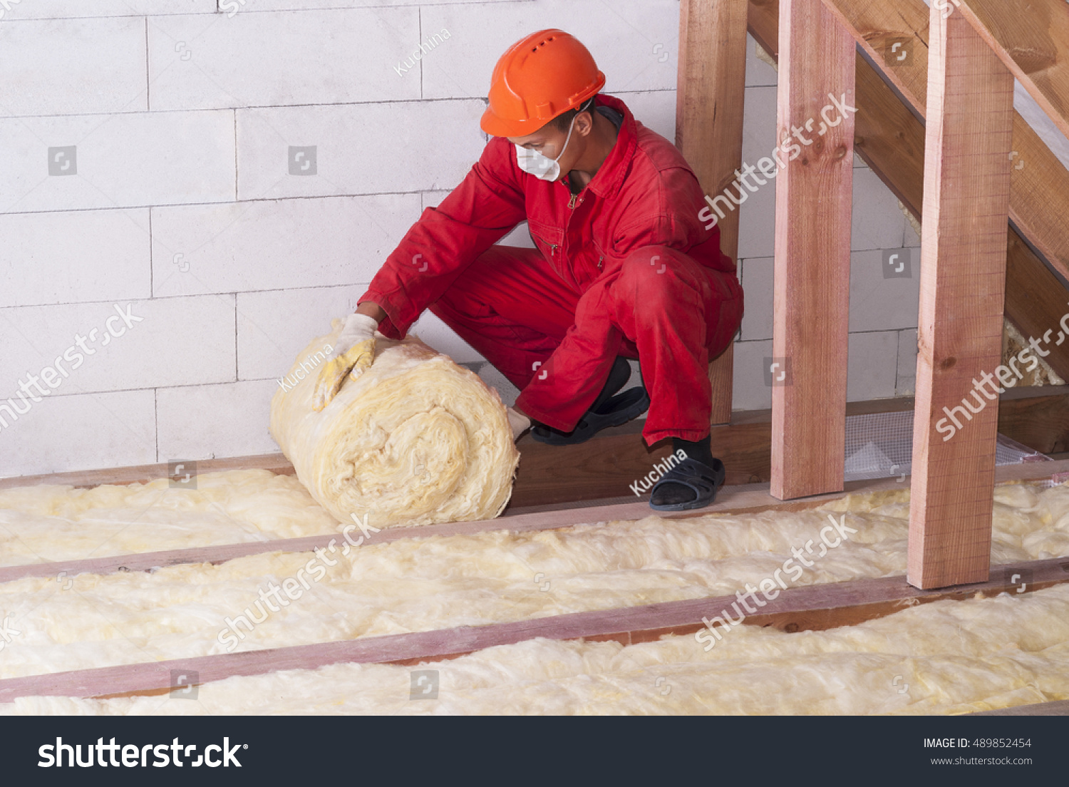 stock-photo-working-insulates-the-attic-with-mineral-wool-489852454