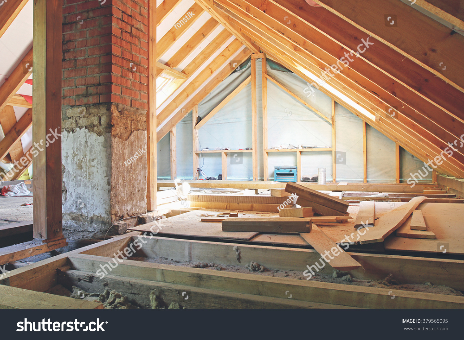 stock-photo-an-interior-view-of-a-house-attic-under-construction-379565095