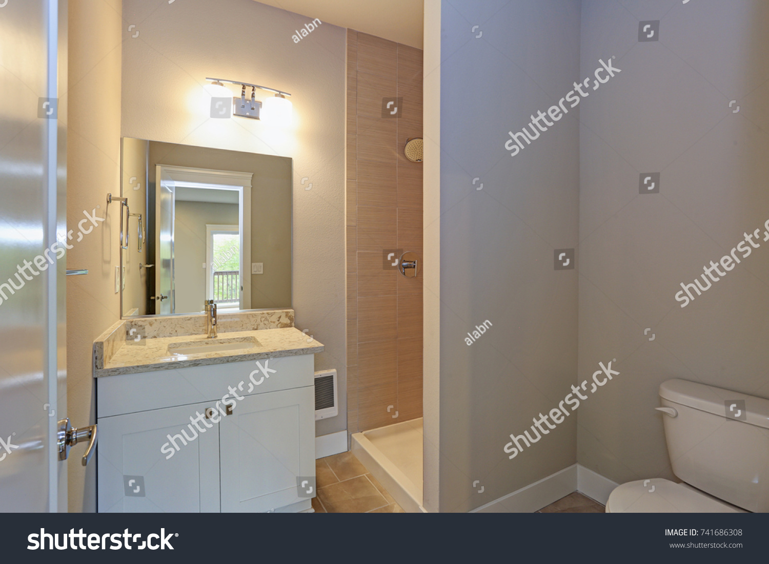 stock-photo-contemporary-white-and-beige-bathroom-with-a-white-bathroom-vanity-under-a-mirror-illuminated-by-741686308