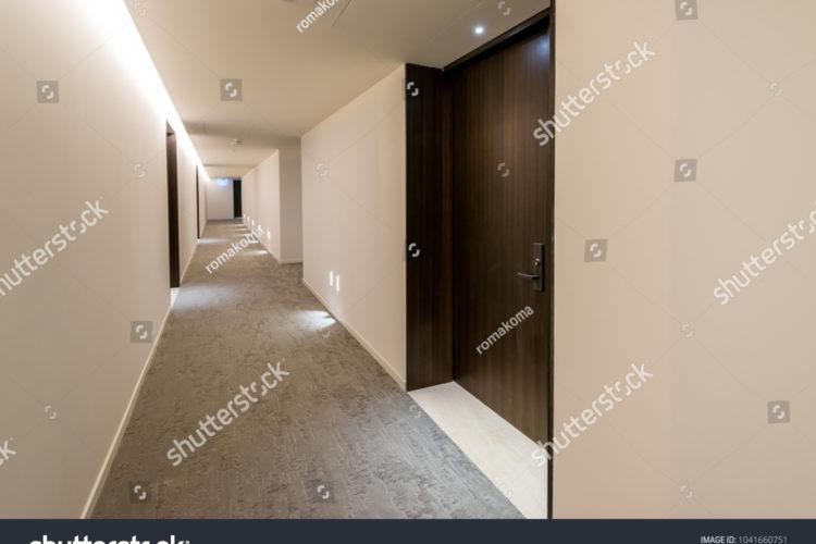 stock-photo-corridor-aisle-of-the-high-rise-condo-building-interiour-design-1041660751
