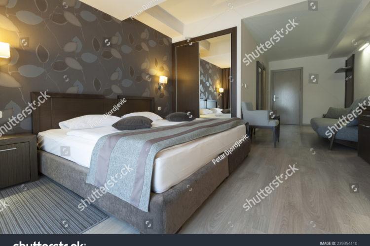 stock-photo-hotel-interior-apartment-bedroom-239354110