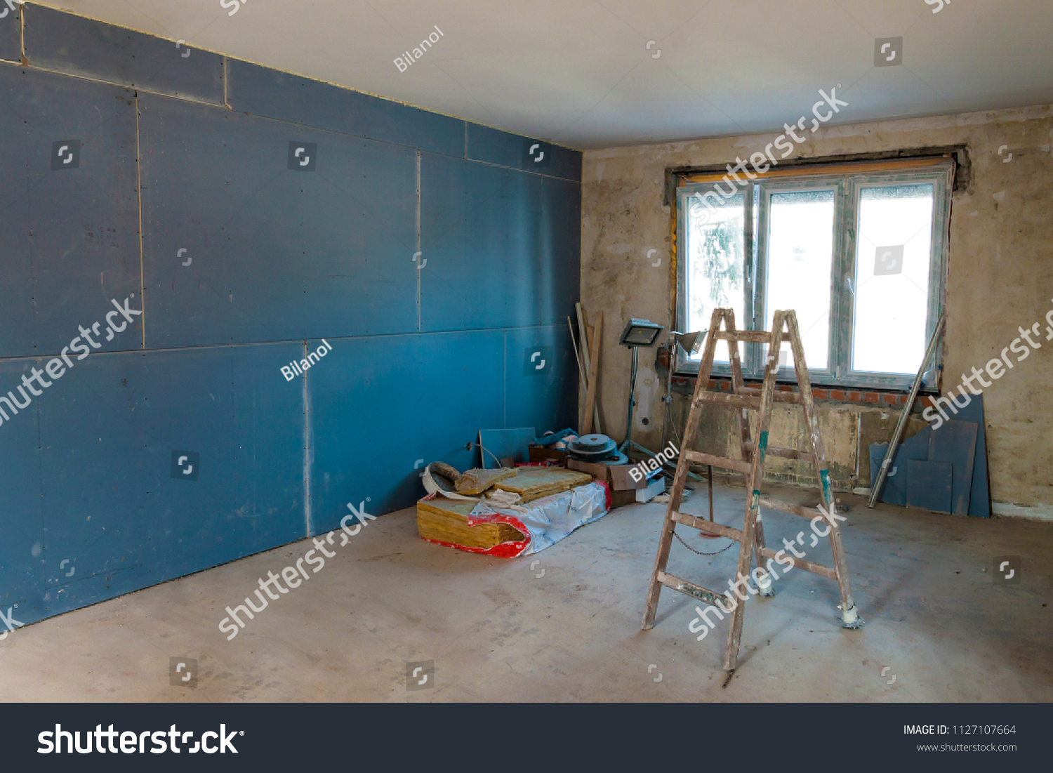 stock-photo-interior-of-a-house-under-construction-renovation-of-an-apartment-1127107664