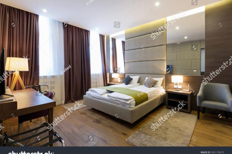 stock-photo-interior-of-hotel-apartment-bedroom-565178473