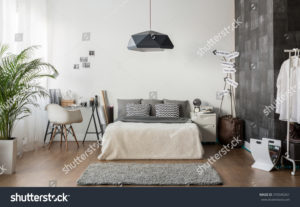stock-photo-interior-of-white-and-gray-cozy-bedroom-370340261