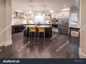 stock-photo-luxury-modern-kitchen-and-dining-room-area-interior-design-551625820