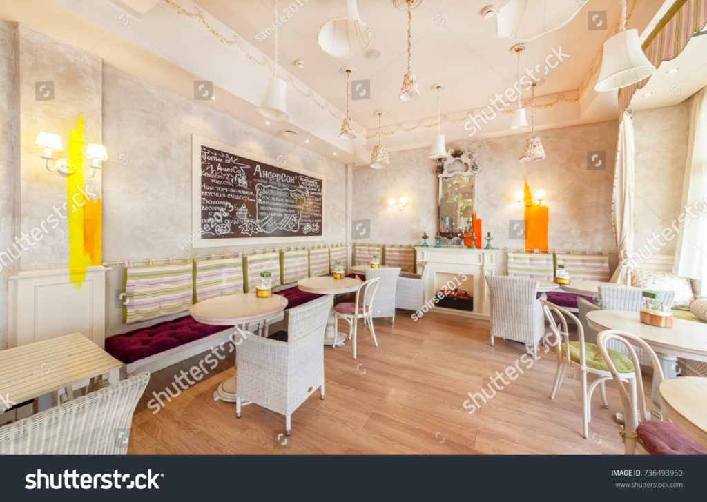 stock-photo-moscow-august-interior-of-the-family-cafe-anderson-hall-with-round-tables-a-long-sofa-736493950