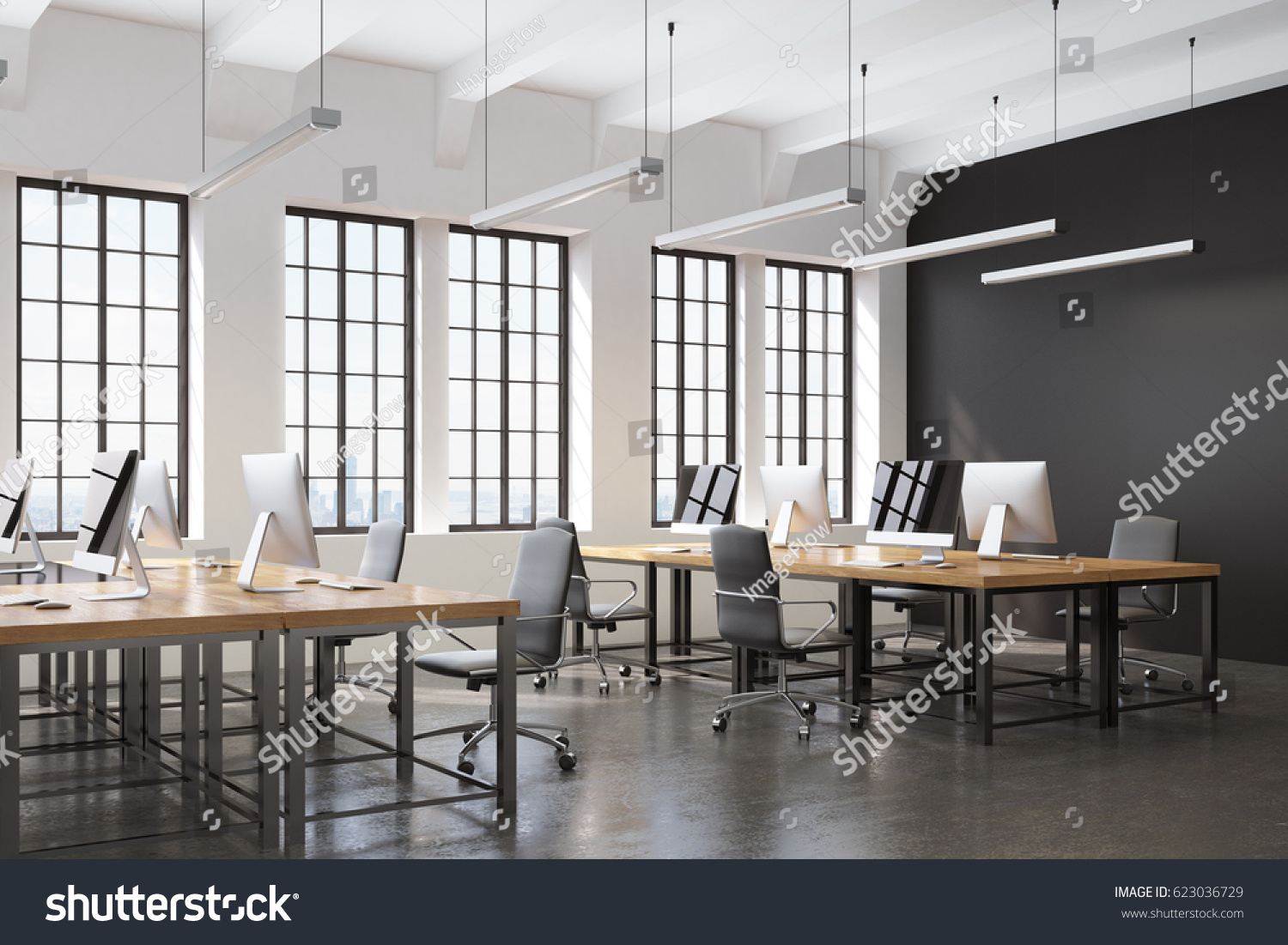 stock-photo-side-view-of-an-open-space-office-with-a-black-wall-many-tables-with-computers-on-them-and-a-623036729