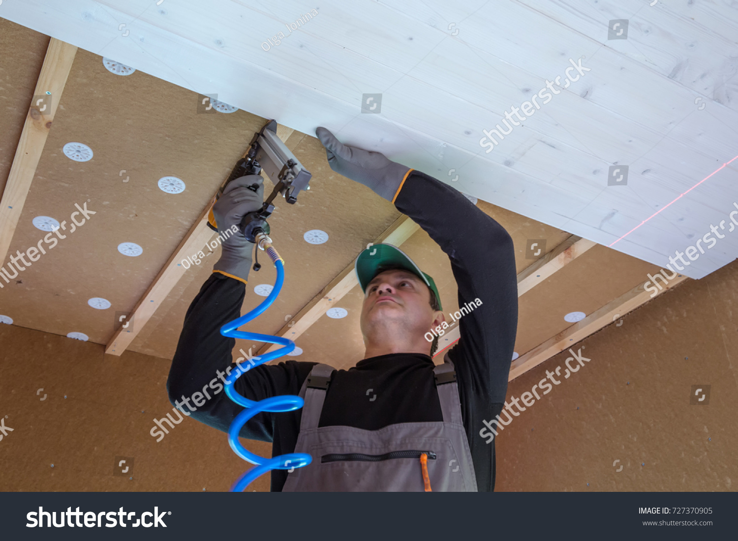 stock-photo-the-worker-produces-finishing-works-of-the-ceiling-with-a-white-wooden-board-construction-worker-727370905