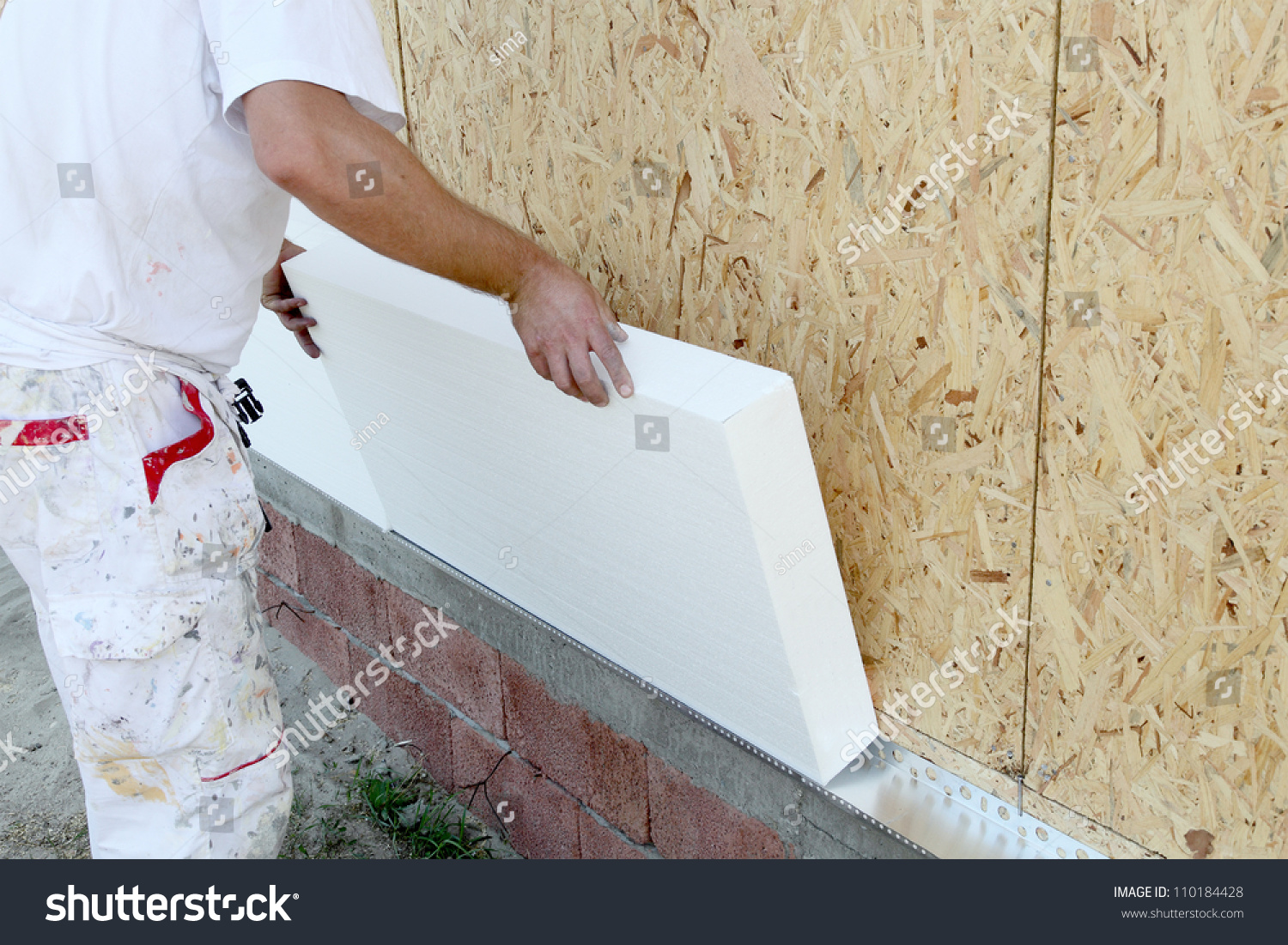 stock-photo-worker-placing-styrofoam-sheet-insulation-to-the-wall-110184428