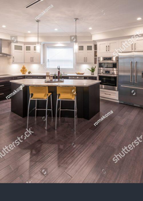 stock-photo-luxury-modern-kitchen-and-dining-room-area-interior-design-551625820