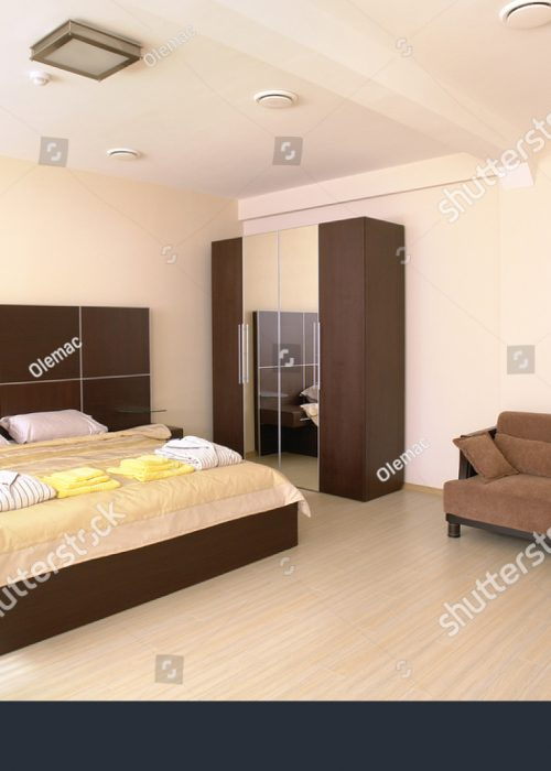 stock-photo-modern-tastefully-and-simply-decorated-bedroom-4763803